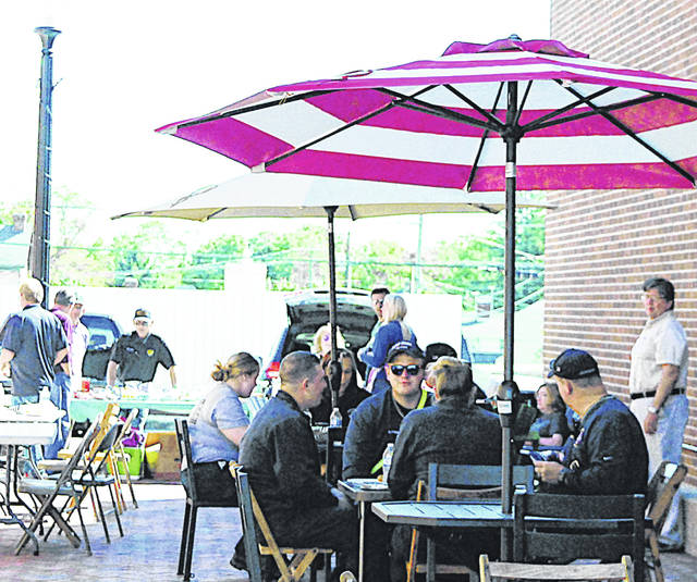 In a scene from last October, the city of Hillsboro hosts a cookout to show its appreciation for local businesses in the space where the Colony Theater once stood.