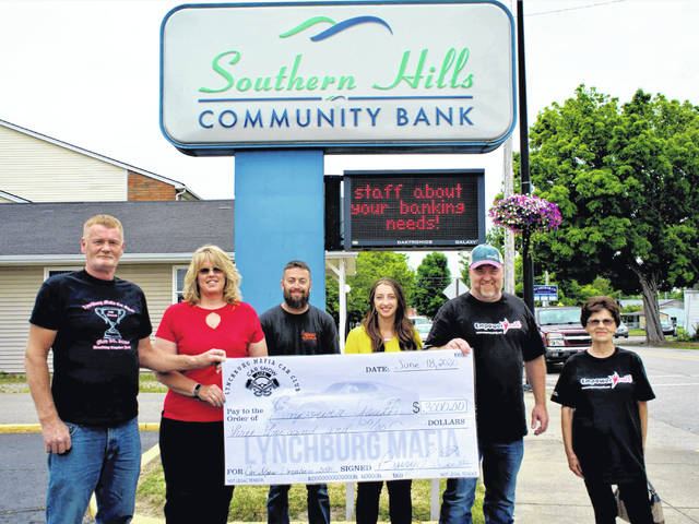 Pictured donating a check for $3,000 to Empower Youth are: Lynchburg Mafia Car Club Members: Barry Custis, Deanna Oaks-Feiss; Robby Biron with Biron Auto Sales; Southern Hills Community Bank Representative Laura Musselman; and Empower Youth Representative Scott Conley.
