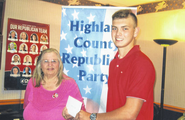 Hillsboro High School graduate Ethan Snapp receives a scholarship for $500 from Judy Mason, president of the Highland County Republican Women's Club.