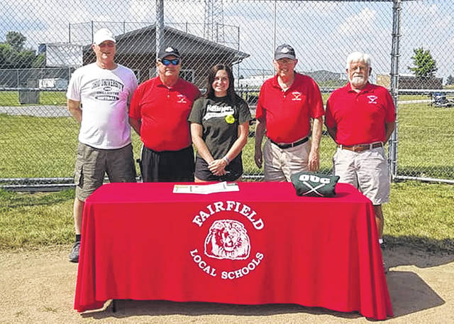 Standing L-R: Ohio University-Chillicothe Softball Coach George Beck, Fairfield Lady Lions Softball Head Coach Mark Dettwiller, Molly Thackston, Coach Tom Purtell, and Coach Matthew Zimmerman