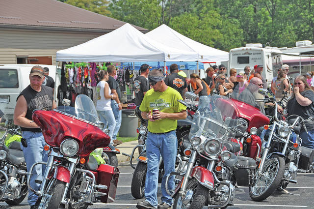 In a scene from a past event, bikers and others gather for the Greenfield Eagles Charity Ride.