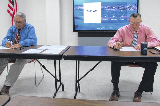 Highland County Board of Commissioners President Jeff Duncan (left) and commissioner Terry Britton are pictured during Wednesday's weekly meeting.