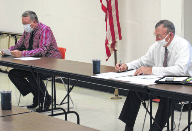 Highland County commissioners Gary Abernathy (left) and Terry Britton are shown during Wednesday's regular meeting.