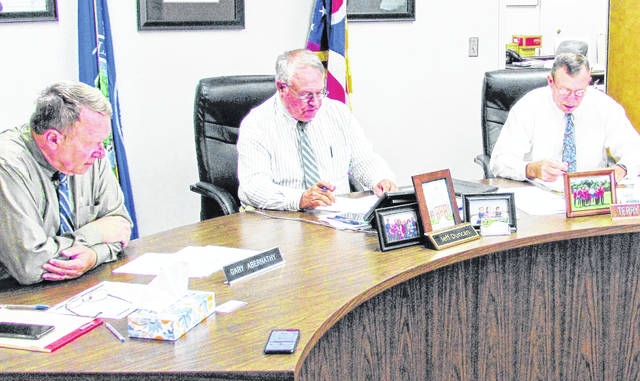 Shown (from left) Highland County commissioners Gary Abernathy, Jeff Duncan and Terry Britton returned to their offices for Wednesday's regularly scheduled meeting.
