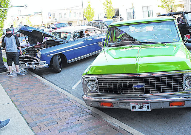 Vehicles like these, parked on South High Street during the inaugural Bring Cruisin' Back to Uptown Hillsboro event on May 9, will be on display during a related event for veterans Saturday, July 11 at Star Cinemas in Hillsboro.
