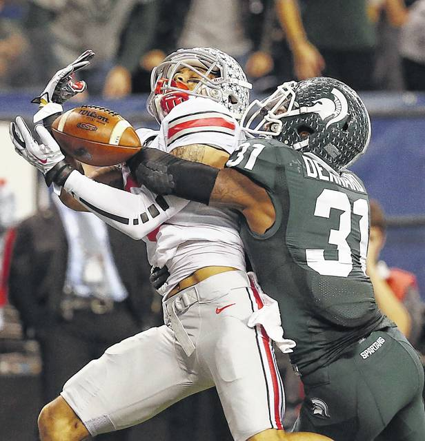 Michigan State's Darqueze Dennard (31) breaks up a touchdown pass intended for OSU Devin Smith in the second half at Lucas Oil Stadium Dec. 7, 2013.