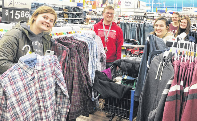 Students shopping for the 2019 Adopt-a-Family program, from left, are Riley Stratton, Joe Helterbrand, Loraleigh Mayhan, Paige Gragg and Alora Brown.