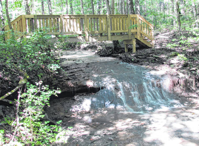 A new footbridge crosses Rocky Fork Creek near a small waterfall on Falls Trail at the Miller Nature Sanctuary.