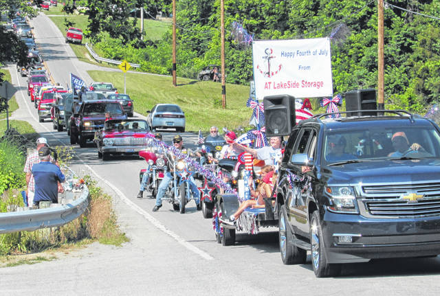 Part of the procession in Saturday's Rocky Fork Lake Business Advisory Committee second annual Rocky Fork Lake Fourth of July Parade is pictured as it heads down North Shore Drive.