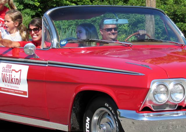 Behind the wheel of one of several classic cars at Saturday's Rocky Fork Lake Fourth of July Parade was State Rep. Shane Wilkin and family.