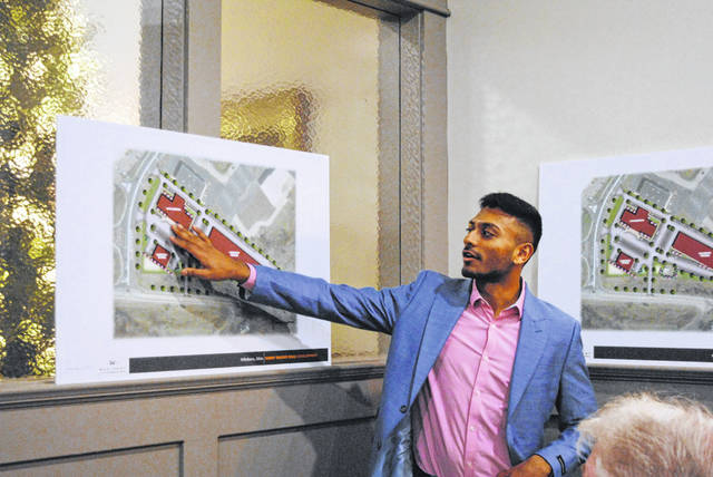 In a scene from a December developers' meeting, developer Ankur Patel explains the proposed layout of the future Hillsboro Marriott hotel and retail plaza to local government officials.