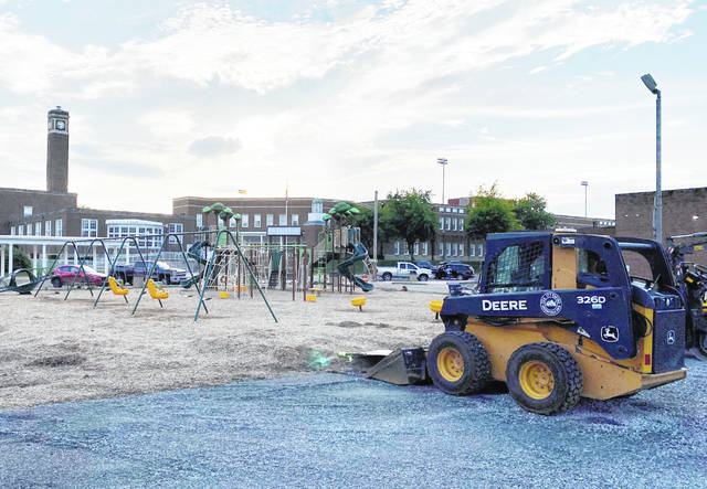 Heavy equipment sits by the new playground on Fifth Street in Greenfield ready to resume work that was halted in March. Work recently began again and includes additional play equipment, parking, sidewalk, curbs, and basketball and four-square areas. Landscaping will follow.