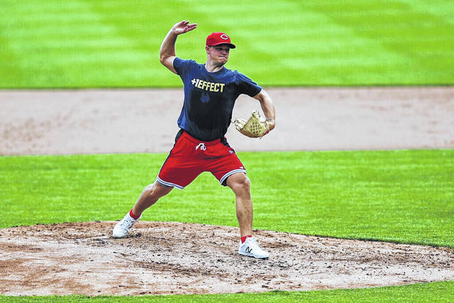 Cincinnati Reds' Sonny Gray participates in baseball practice at Great American Ballpark in Cincinnati on Wednesday. Gray will start the 60-game season and lead a rotation that he joined only last year, manager David Bell announced Wednesday.