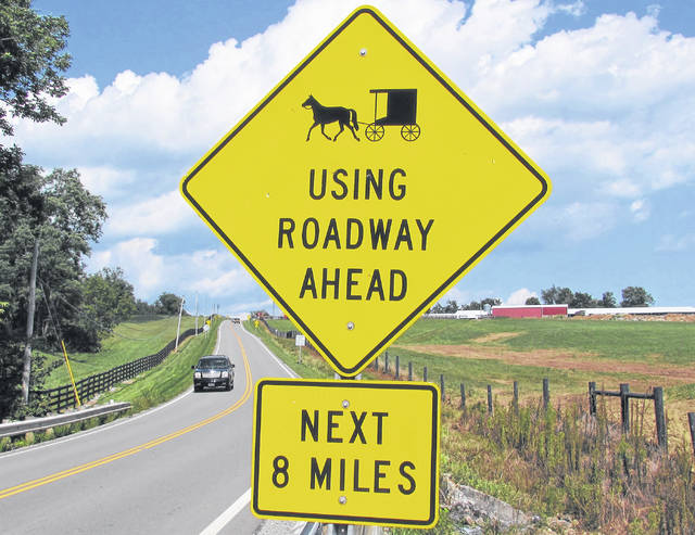 This sign on SR 138 just east of Hillsboro warns drivers of buggies that could be on the road.