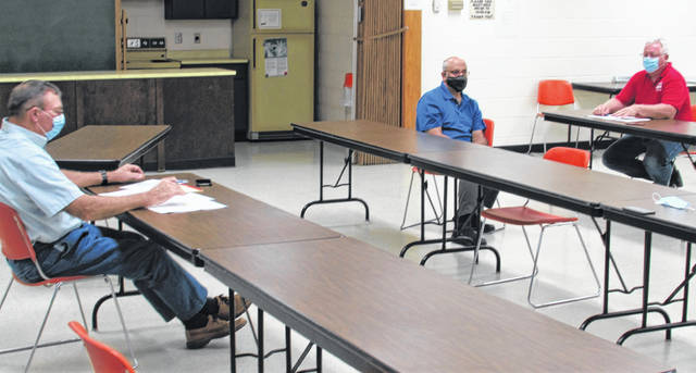 Shown, from left, during Thursday's meeting of the Highland County Land Bank are board member and county commissioner Terry Britton, Land Bank Vice-Chair Charlie Guarino, and Highland County Community Action Organization Housing Director Mark Current.