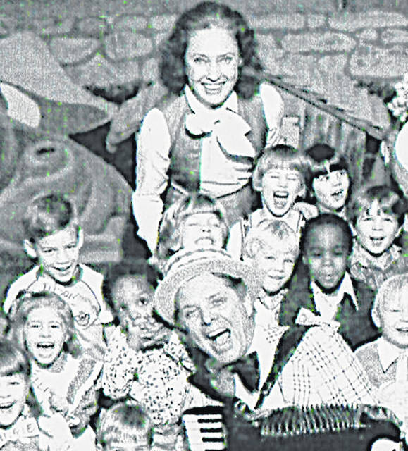 "Wanda Lewis (at top) helped keep an eye on the children while her husband ""Uncle Al"" Lewis entertained them on the accordion during a taping of the children's TV show at WCPO-TV in Cincinnati."