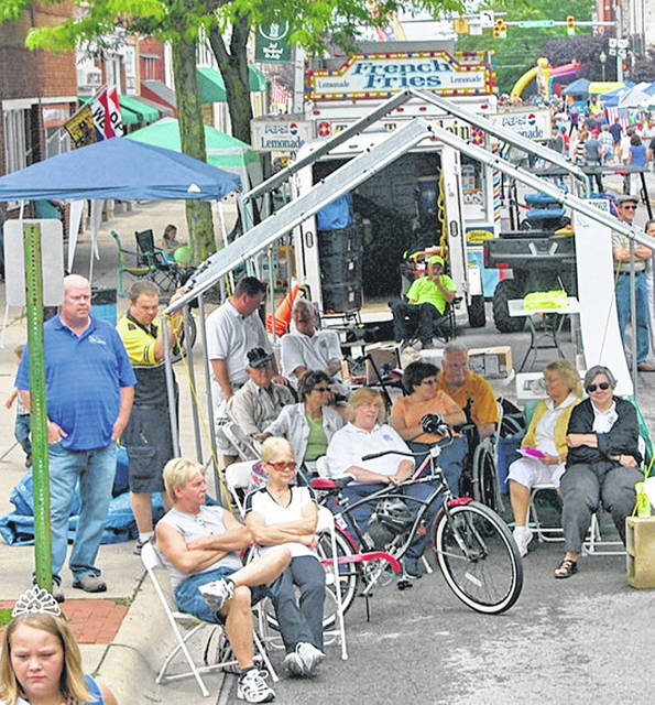 Residents are gathered on Jefferson Street in Greenfield during a past Rotary Club auction at the Greene Countrie Towne Festival.