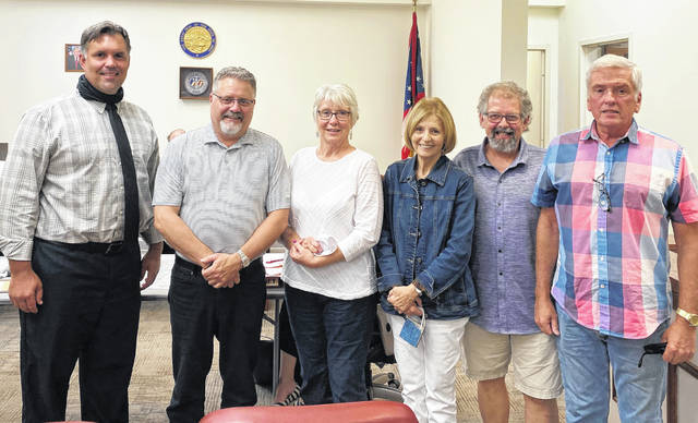 The G3 Design Committee was recognized with a Citizen of the Month Award for its efforts to have Greenfield's downtown designated as a historic district. The design committee members present at Tuesday's meeting are pictured with city manager Todd Wilkin (far left). The G3 members (l-r) are Doug Karnes, Susan Thompson, Connie Clyburn, Tom Schluep and Steve Pearce.