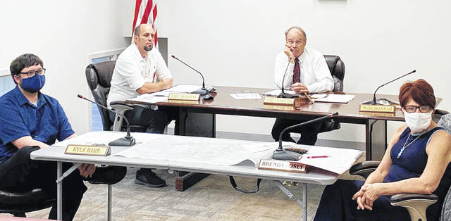Greenfield Council members (l-r) Kyle Barr, Eric Borsini, Phil Clyburn and Brenda Losey are pictured at Tuesday's meeting. Councilman Mark Branham was excused from the meeting.