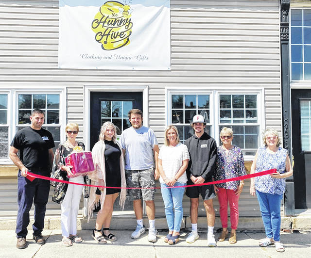 The village of Leesburg held a ribbon-cutting to welcome its newest business, The Hunny Hive LLC, owned by Hannah Willey. The new boutique is located at 47 S. Fairfield St. and offers women's clothing, children's clothing, along with unique gifts and home decor. Hours of operation are Thursday and Friday, 11 a.m. to 5 p.m. and Saturday, 11 a.m. to 3 p.m. You can reach The Hunny Hive by calling 937-763-8000. In addition, you can visit them on Facebook or Instagram @thehunnyhivellc. You can reach Hannah Willey by email at hanwilley@icloud.com. Pictured (from left) are Shawn Willey, councilwoman Rita Smith-Daulton, owner Hannah Willey, Josh White, Natalie Willey, Wyatt Willey, Dianna Robertson Fordyce and Mayor Shawn C. Priest.