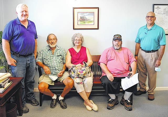The Highland County Land Revitalization Corporation (land bank) made its first two transactions recently on a couple pieces of property in the Rocky Fork Lake area. One is on Dundee Drive where James and Wanda Williams plan to develop the property, and the other is on Venetian Way where Frank Eicher plans to build a pole barn with a living quarters for camping with plans to make a more permanent home when he retires. Pictured (from left) are Mark Current with Highland County Community Action, James Williams, Wanda Williams, Frank Eicher, and Highland County Land Bank Vice President Charlie Guarino.