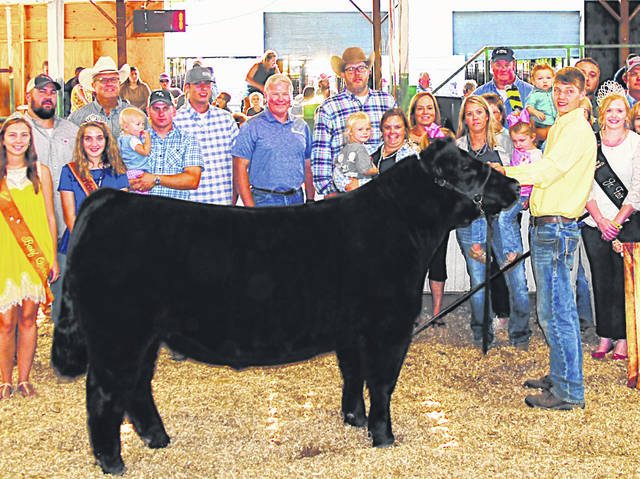 Due to the COVID-19 pandemic, scenes like this one of Caden Hess selling his Grand Champion Market Steer a year ago will be missing at the Highland County Fair this year due to the elimination of live auctions.
