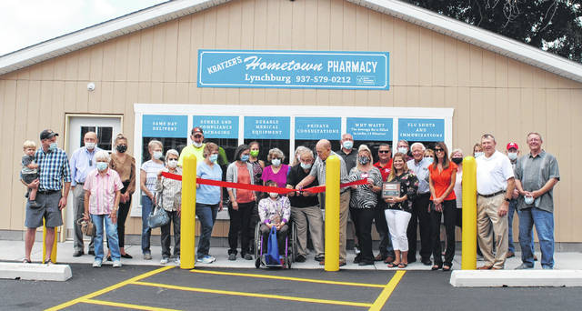 Lynchburg and county officials and community members gather to celebrate the grand opening of Kratzer's Hometown Pharmacy in Lynchburg on Tuesday.