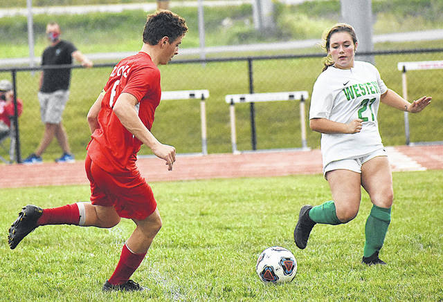 Fairfield's Reese Teeters makes a move into the box against a Western defender on Thursday at Fairfield High School where the Lions defeated the Indians 6-2. Teeters recorded a hat trick in the match.
