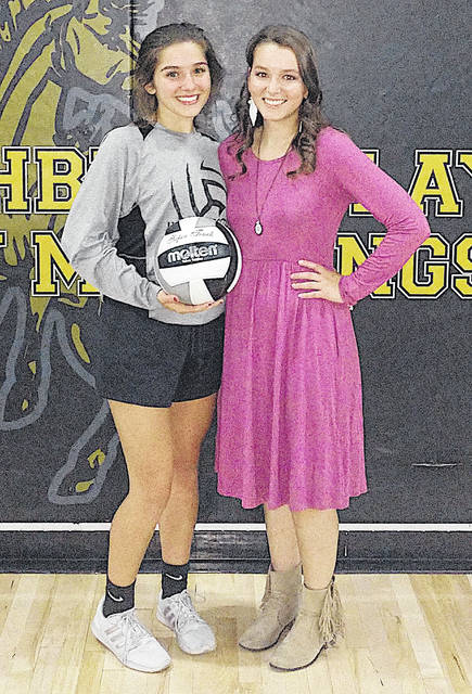 Lynchburg-Clay's Abby Pitzer (left) is pictured with L-C Vollyeball Coach Mackenzie Stevens at Lynchburg-Clay High School on Tuesday night. Pitzer recorded her 1,000th career assist in the Lady Mustangs Southern Hills Athletic Conference contest against the visiting West Union Lady Dragons.