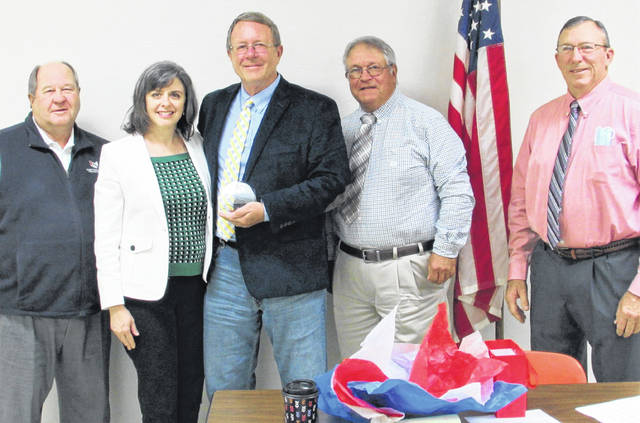 A recognition of service award was presented to Gary Abernathy on the occasion of his final meeting Wednesday as a Highland County commissioner. Shown, from left, are County Commissioners Association of Ohio Assistant Director John Leutz, executive director Cheryl Subler, Abernathy, and commissioners Jeff Duncan and Terry Britton.