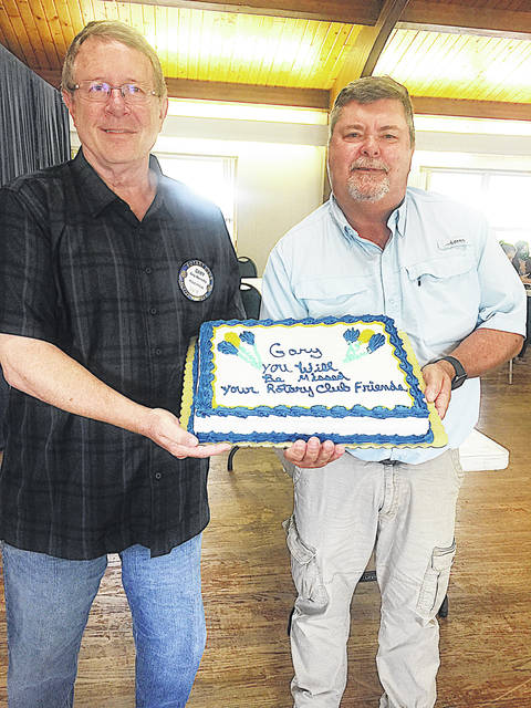 Outgoing Highland County Commissioner Gary Abernathy (left) is pictured being honored Tuesday after resigning following 10 years as a member of the Hillsboro Rotary Club. Abernathy is moving out of the area. His last meeting as a county commissioner will be Wednesday. Also pictured is Hillsboro Rotary Club President Darrell Wilson.
