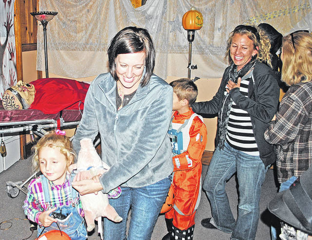 Visitors react in this photo from a past haunted house held on Beggars' Night in The Times-Gazette offices.