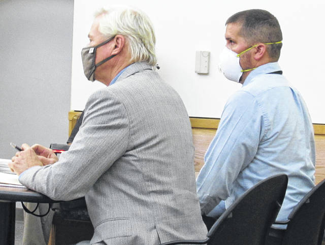 Shown are attorney James Boulger (left) and Roy Stephens during Thursday's pretrial hearing in Hillsboro Municipal Court.