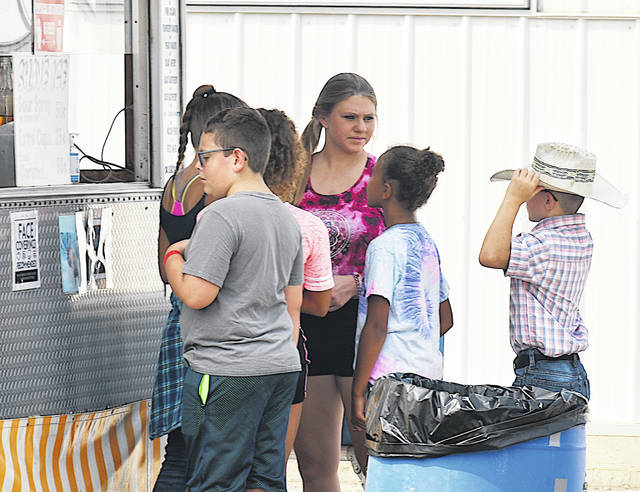 The Highland County Fair will open its gates to the public Friday so food can be purchased from vendors. In this photo kids gather around a vendor stand at the fair Wednesday.