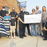 Groups combine to raise $1,615 for Hillsboro Police Department