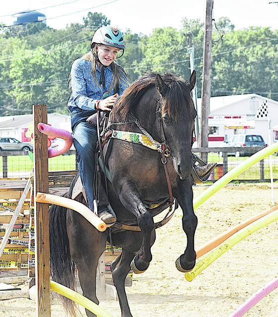 Kailyn Greer takes part in the Extreme Trail competition Tuesday at the 2020 Highland County Fair. The Jr. Fair schedule in this year's fair shortened by COVID-19 wraps up Wednesday. On Thursday buyers will be allowed to visit the Wharton Building on the fairgrounds from 6 a.m. to 10 p.m. to select the exhibitors they would like to make donations to. On Friday the fairgrounds will be open to the public with no admission fee for anyone wanting to purchase fair good from the vendors.