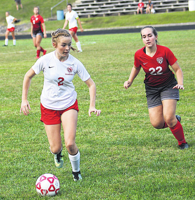 Fairfield's Ella Newkirk looks for an opening during the Lady Lions 4-2 win Monday at Minford.