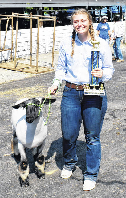 Chandra Hill, pictured here with her goat named Cash, won the 2020 Highland County Fair Grand Champion award for Sweepstakes Sheep Showmanship on Tuesday.