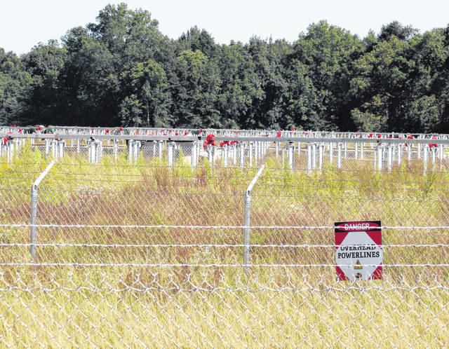 Mounting posts that will soon hold thousands of solar panels extend in straight rows at the Hillcrest Solar Panel Farm on Greenbush-East Road, about four miles west of Buford.