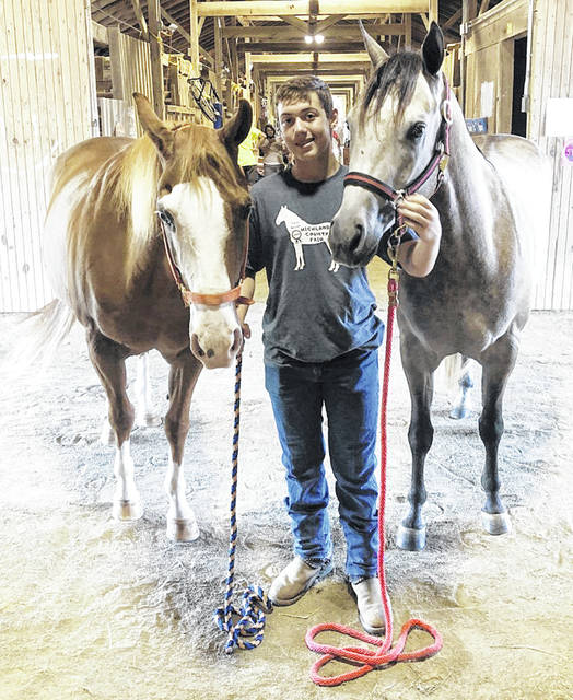 Ryan Mau is pictured with both of his horses.