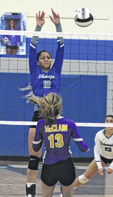 Washington's Jeleeya Tyree-Smith (12) makes the block during the match Tuesday against McClain.