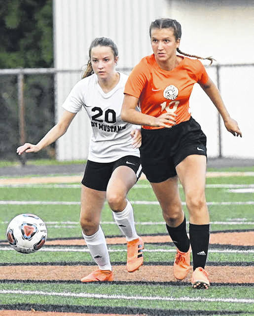The undefeated Lynchburg-Clay girls soccer team handed the Wilmington Lady Hurricane a 4-0 loss Thursday at Alumni Field in Wilmington. Lynchburg-Clay improved to 4-0 with the win while the Wilmington girls fell to 0-4. A Lady Mustang (left) and Lady Hurricane battle for the ball in this picture. Lynchburg-Clay is off next week and returns to action Wednesday, Sept. 16 when it hosts Unioto.