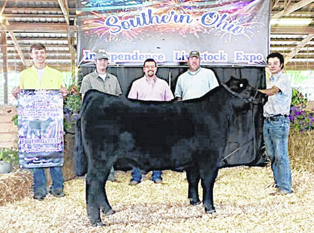 Gavin Puckett is pictured with his fat steer.
