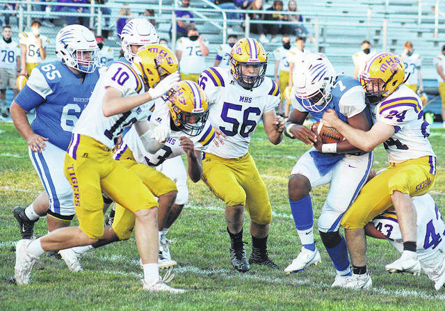 Washington quarterback Ethan Rogers-Wright (7), the quarterback is about to be swamped by several McClain defenders include (from left) Seth Wise (10), Landen Eubanks, (3), Justin Kegley (56), Emerson Yates (24) and Cade Sponcil (43) Also pictured in Washington's Ezekiel Watson (66).