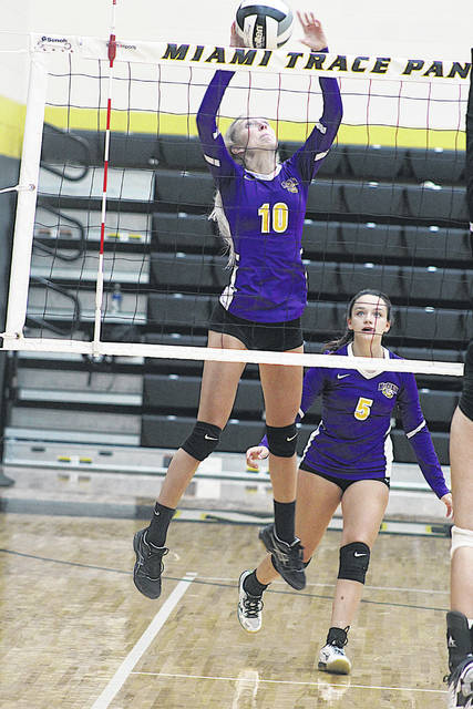 McClain's Jaelyn Pitzer attacks the net Tuesday against state-ranked Miami Trace.