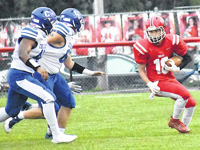 Hillsboro returner Michael Kaufman attempts to evade Chillicothe defenders earlier this season.