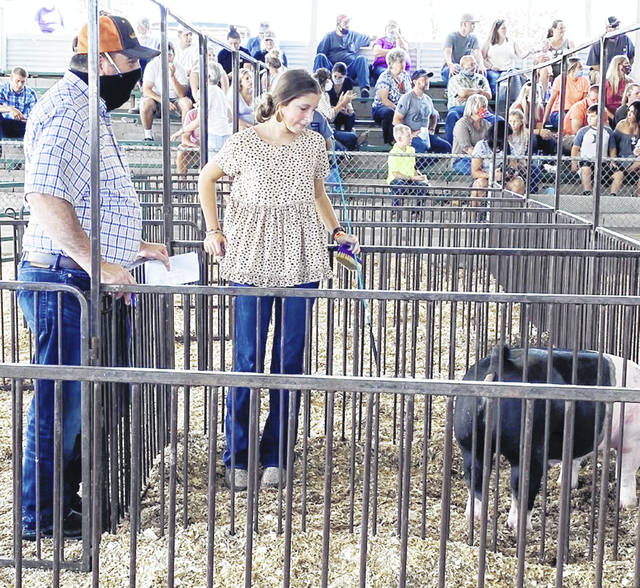 Lydia Carr is pictured with one of her animals in the market hog class.