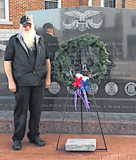 "Gerold ""Buzzard"" Wilkin with the local Highlanders Sons of the American Revolution is pictured placing a wreath Friday at the veterans memorial at the Highland County Courthouse in Hillsboro in recognition of POW/MIA Recognition Day. National POW/MIA Recognition Day is observed on the third Friday in September. It honors those who were prisoners of war and those who are still missing in action. It is most associated with those who were POWs during the Vietnam War. Wilkin is a Vietnam veteran."
