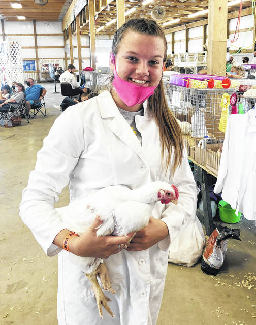 Pictured is Allie Crago with one of her Market Meat Chickens at the Highland County Fair.