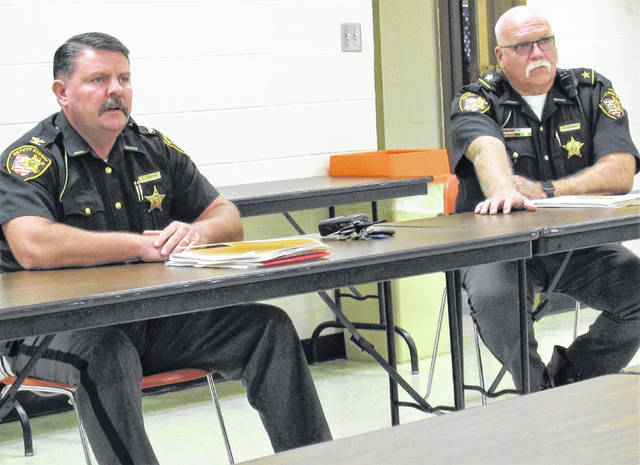 Pictured are Highland County Chief Deputy Brandon Stratton (left) and sheriff Donnie Barrera at the county commissioners' Wednesday meeting.